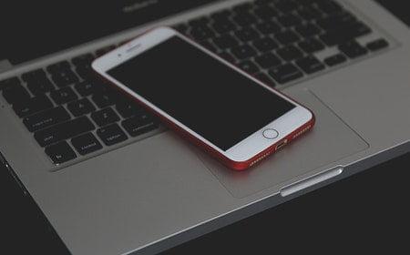 Mobile on laptop keyboard