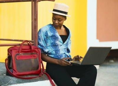 laptop using beside bag
